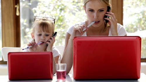 mom-kid-girl-laptop-phone-getty
